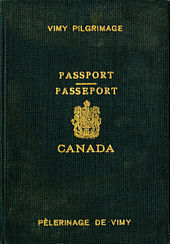 A Passport with the Canadian coat of arms in the middle and text  in both French and English identifying the book as a passport for the Vimy Pigrimage