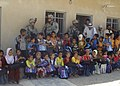 2-320th FAR & ISF give to Iraqi school children DVIDS90855.jpg