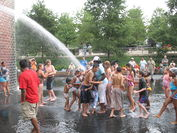 The fountain spouting water on frolicking children