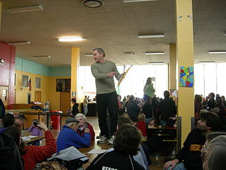 Caucus - Precincts from Washington State's 46th Legislative District caucus in a school lunchroom (2008).