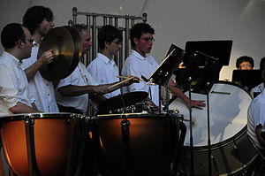 Percussion instrument - Orchestral percussion section with timpani, unpitched auxiliary percussion and pitched tubular bells