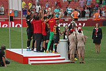 A coloured photograph of the Galatasaray squad standing on the podium and celebrating their Emirates Cup win.