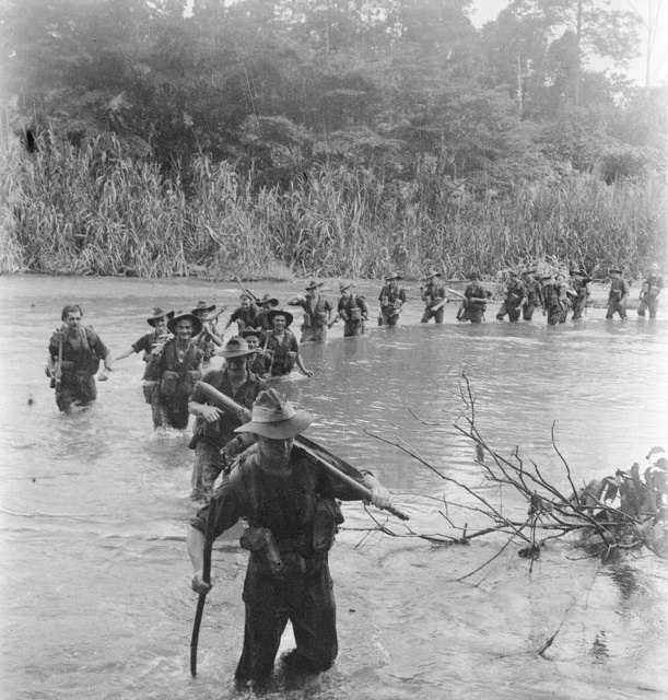 37-52 Battalion soldiers crossing a river in New Britain