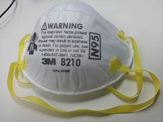 Respirator Device worn to protect the user from inhaling contaminants