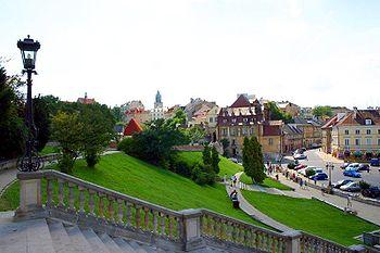 Polski: Plac Zamkowy z panoramą Starego Miasta