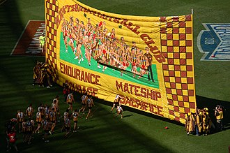 Hawthorn Football Club - The Hawks ran out onto the MCG on Grand Final Day in 2008, with the banner saying: Endurance, Mateship, Courage, Sacrifice