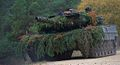 A Leopard 2 manuevers through the terrain.jpg