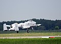 A U.S. Air Force A-10C Thunderbolt II aircraft assigned to the 104th Fighter Squadron, Maryland Air National Guard takes off for a familiarization flight before the start of Saber Strike 2013 at Amari Air Base 130602-Z-FO407-002.jpg