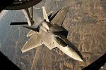 A U.S. Air Force F-22 Raptor backs away from a KC-135 Stratotanker after conducting an in-flight refueling during a training mission over central New Mexico on 131023-F-GR156-225.jpg