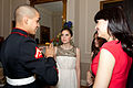 A U.S. Marine Corps lance corporal, left, talks with guests during the Evening Parade reception May 24, 2013, at the Home of the Commandants in Washington, D.C. Evening Parades, a tradition dating to 1957, are 130524-M-MM982-044.jpg