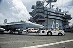 A U.S. Marine F-A-18C Hornet aircraft assigned to Marine Fighter Attack Squadron (VMFA) 312 is re-positioned on the flight deck of aircraft carrier USS Harry S. Truman (CVN 75) June 10, 2013, while underway 130610-N-PL185-118.jpg