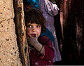 A girl watches U.S. and Afghan soldiers as they visit with elders in a village in Zabul province, Afghanistan, May 26, 2013 130526-A-QA210-487.jpg