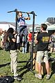 A participant, center, performs pull-ups to earn an Army backpack from the U.S. Army display booth during the Tough Mudder event in San Diego Nov. 10, 2013 131110-A-BE931-017.jpg