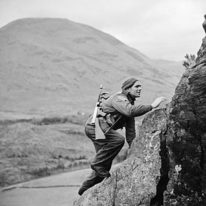 No. 1 Commando - A soldier from No. 1 Commando climbs up a steep rock face during training at Glencoe, Scotland, 19 November 1941.