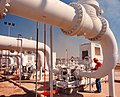 A technician at the Strategic Petroleum Reserve inspects crude oil transfer pipe.jpg