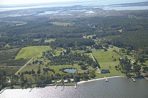Deal Island Wildlife Management Area - Aerial view of Deal Island WMA behind a residential area