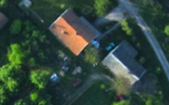 Orthophoto - This photo is assembled from several overlapping photos from UAV, completely removing any residual tilt of the buildings. This is a True Orthophoto.