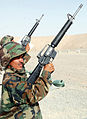 Afghan National Army recruits perform safety checks on their weapons at the small arms range. (4782335415).jpg