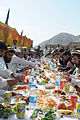 Afghan men feasting by mountains.jpg