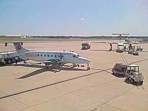 Air Georgian - An Air Georgian Beechcraft 1900D (left) at Bradley International Airport in Air Alliance livery