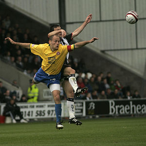 Alex Neil (footballer) - Neil (in yellow) playing for Hamilton Academical in 2009