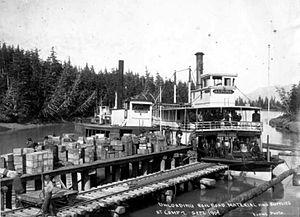 Altona (sternwheeler) - Altona and another steamer unloading rail supplies in Alaska, 1907