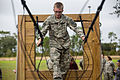 An Army Junior Officer Training Corps cadet navigates a three-rope-bridge on the 7th Special Forces (Airborne) compound.jpg