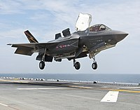 An F-35B Lightning II aircraft lands aboard the amphibious assault ship USS Wasp (LHD 1).jpg