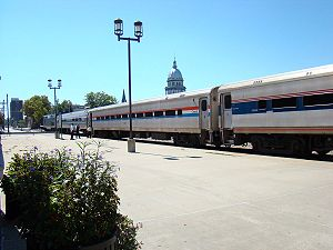 Ann Rutledge (train) - The Ann Rutledge in Springfield, Illinois. A GE Genesis leads the train, with an Amfleet coach and two Horizon Fleet coaches visible. The Illinois Capitol building can be seen over the center car.