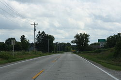 Looking south at the welcome sign for Anston
