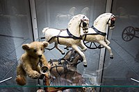 Antique toy team of horses and saxophone-playing bear (26431659375).jpg