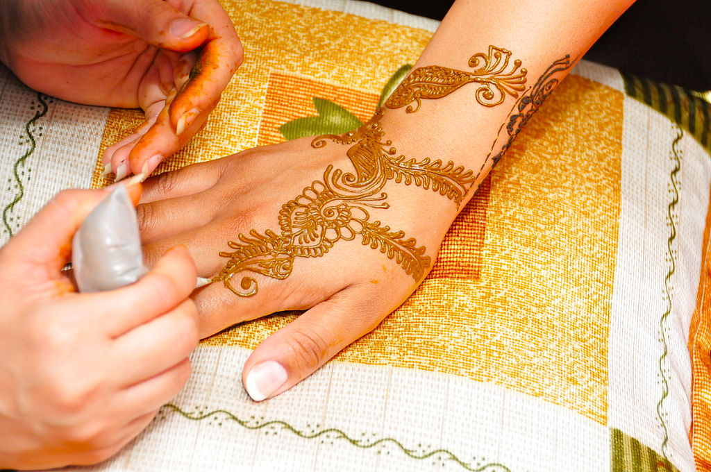 Applying Mehndi