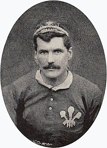 Upper body shot of Gould wearing his Wales cap and jersey