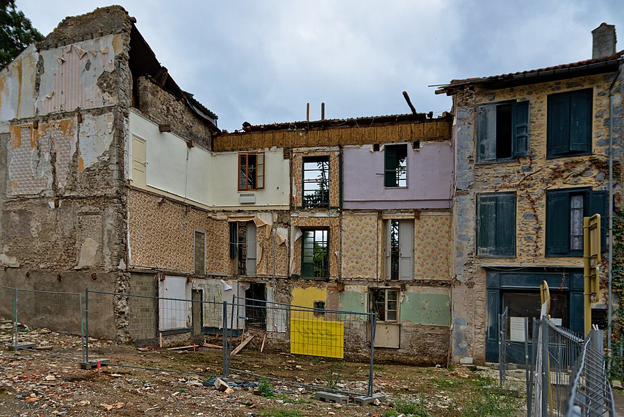 Building being destroyed in Aspet, Haute-Garonne, France.