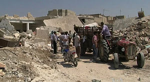 2012 Aleppo Governorate clashes - Image: Azaz Syria during the Syrian Civil War Displacement with Tractor