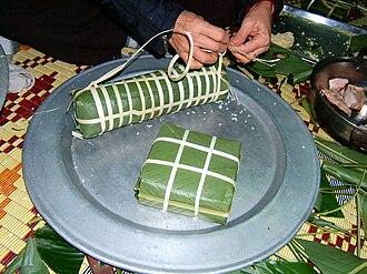 Bánh chưng - Bánh chưng, the square one, in comparison with bánh tét, the cylindrical one.