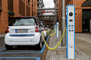 Electric vehicle network - Several Smart electric drive cars charging at the Potsdamer Platz in Berlin.