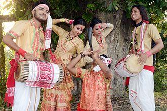 Dhol - Men playing Assamese dhol during Bihu, Assam, India
