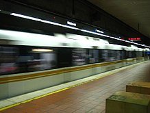 A Blue Line train enters 7th Street/Metro Center, its terminus.