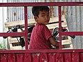 Boy on Moto - Stung Treng - Cambodia (48429010087).jpg