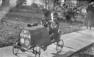 Quadracycle - Boy on Pedal Car