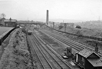 Bradley railway station - Site of Bradley Station View NE, towards Bradley Wood Junction and Brighouse (left), Heaton Lodge Junction and Mirfield (also Spen Valley loop) (right)