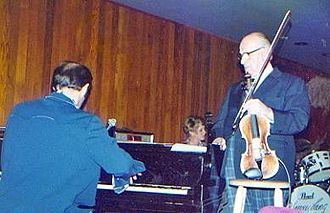 Joe Venuti - Joe Venuti (right) with the Bubba Kolb Trio at the Village Jazz Lounge, Walt Disney World, in 1978