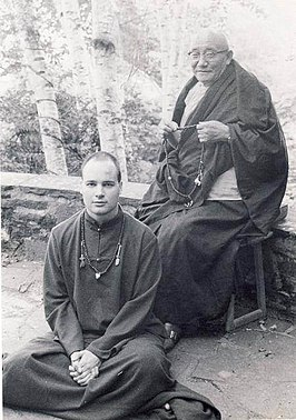 Buddhist scholars - Dezhung Rinpoche III seated on a stool, Chris Wilkinson, student seated at the feet of his lama, wearing Buddhist robes, malas, likely Seattle, Washington, USA (16134833232).jpg