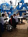 CDE team talk with visitors to the stand at Bauma 2013 (8654181749).jpg