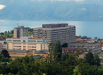 Healthcare in Switzerland - View of the University Hospital of Lausanne (CHUV) and Lake Léman.