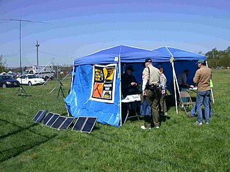 Amateur radio emergency communications - Solar-powered Amateur Radio Station in tents. Note the portable VHF/UHF satellite and HF antennas in the background