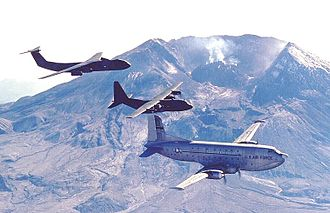 62d Airlift Wing - C-124, C-130, and C-141 with Mt. St. Helens in the background