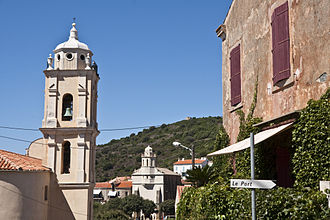 Greek diaspora - Street in Cargèse (Karyes), Corsica (founded by Maniot refugees), with a Greek church in the background