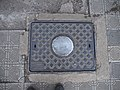 Cast iron utility cover in Asmara, Eritrea (30142134424).jpg